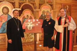 Fr. Loposky, Fr. Denny and Bishop Sean with the plaque.